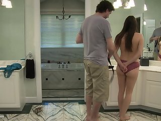 Brunette teen forced to suck cock and thing embrace in a bathroom
