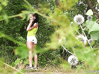 Fine incomprehensible young dame in the forest undresses and masturbates
