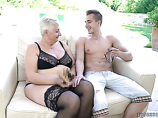 Mature short haired blonde nympho in black stockings is fucked doggy hard